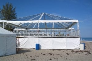 Custom built elevated decking with a 40'' x 40'' clear tent on top.