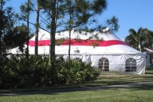 30' x 60' pole tent with horizontal red stripe and window sidewalls.