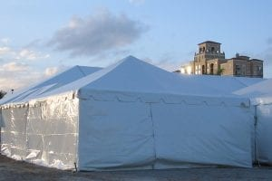 8'' high white sidewalls on a 20'' x 20'' frame tent.