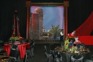 "A ""Night in Spain"" themed fundraiser featuring custom built 15' x 15' picture frames and creative centerpieces."