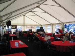 Interior view of a 30' x 60' car corral tent at the annual 12 Hours of Sebring race with window sidewalls.