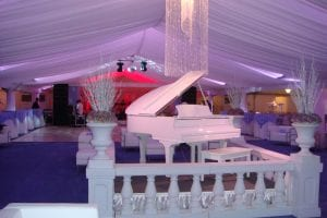 40'' x 100'' tent liner with custom chandelier and back lit with violet lighting.