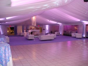 40'' x 100'' tent liner with custom chandelier and back lit in violet lighting.
