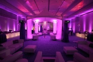 Purple color washing with par 38 light fixtures and ceiling effects lighting with Martin Mania DC1 light fixtures.