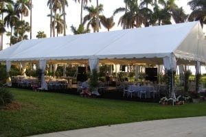 Fundraiser held in a 40' x 80' gable ended frame tent with custom built flooring, tent liner, and leg drapes.