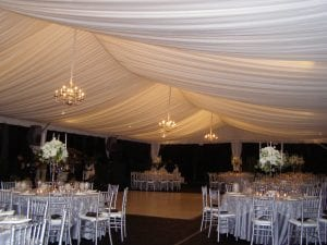 Medium silver chandeliers in a 40' x 80' frame tent