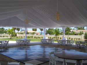 50'' x 75'' tent liner with leg drapes and 7 tier chandeliers.
