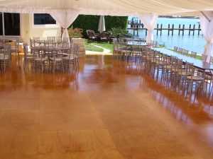 Custom built stained and varnished wood floor in a 30'' x 70'' frame tent.