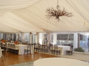 40'' x 90'' tent liner with leg drapes, clear sides and custom chandelier.