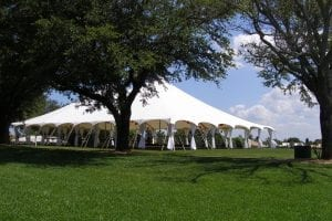 Wedding at a country club featuring a 60' x 90' pole tent with leg drapes and Chinese paper lanterns.