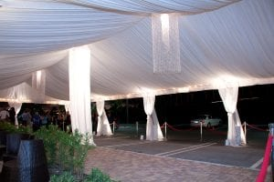 30'' x 60'' tent liner with leg drapes and custom chandeliers.