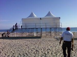 Two 15' x 15'' hi-peak tents on custom built stage.