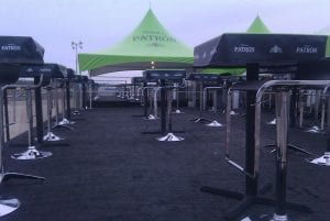 Staging with black carpet and customer furniture for VIP area.