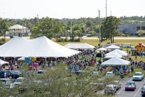 Corporate picnic for 2,000 guests featuring a 60' x 90' pole tent for dining, multiple smaller frame tent for food and games, and hi-end rides and attractions.