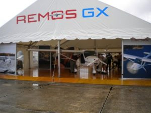 40' x 40' gable ended display tent for a corporate customer at an airshow featuring custom logo, and stained and varnished wood flooring with custom edging.
