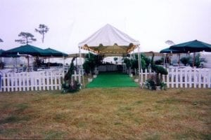9'' wide marquee tent used as an entrance to a picnic.