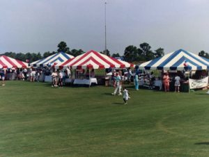 20' x 20' frame tents in blue and white and red and white stripes.