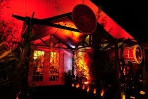 Far east themed event featuring custom gazebos for entrance, bamboo trees, specialty lighting, and Asian inspired decor.