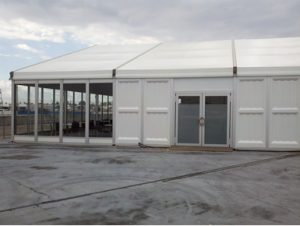 20m x 15m structure tent with glass wall, hard walls, and french doors.