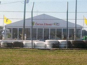 15m x 15m structure tent with glass walls and custom logo.