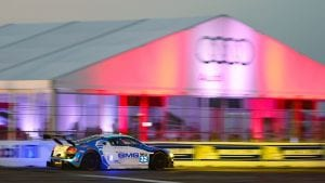 20m x 15m clearspan tent with glass walls and custom logo at the annual 12 Hours of Sebring race.