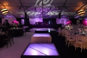 Stage and dance floor lighting with gobo images and lighted frosted stages.
