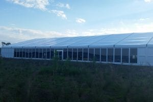 25m x 45m structure tent with glass walls and hard walls.