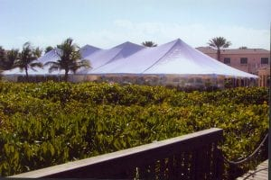 60'' x 150'' pole tent with clear sidewalls.