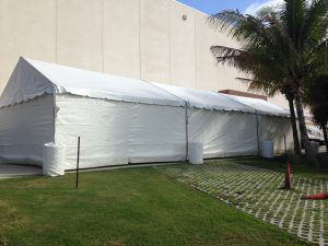20' x 60' gable ended frame tent with white sidewalls.