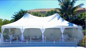 20' x 40' hi-peak tent with flooring and white carpet.