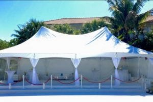 20' x 40' hi-peak tent with flooring and white carpet.