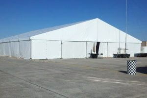 25m x 30m structure tent with with white sidewalls.