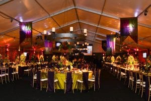 Black tie fundraiser in a 20m x 45m structure tent featuring custom build midieval chandeliers, color washed ceiling, and custom made midieval flags.
