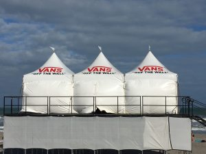 Three 10' x 10' hi-peak tents with white sidewalls and customer logos.