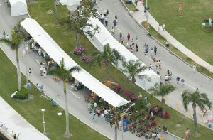 9' x 100' marquee tents used for outdoor covered booths at a flower show.