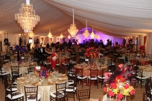 Black tie fundraiser held in a 20m structure tent with tent liner, wall drape, 12 chandeliers, and mahogany chiavari chairs.