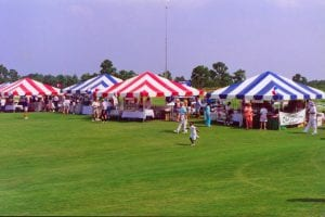 20'' x 20'' frame tents in blue and white and red and white stripes.