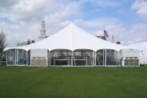60'' x 60'' pole tent with clear sidewalls and air conditioning.