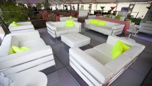 Frosted acrylic staging with white leather furniture.