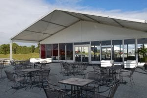 15m x 15m tent with porch and glass walls.