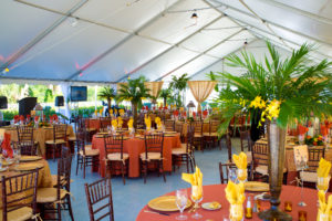 Awards luncheon in a 50' x 90' frame tent featuring mahogany chiavari chairs with tropical centerpieces.