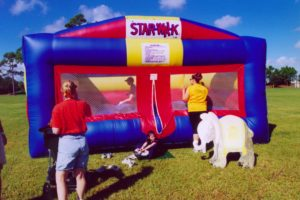Bounce house at a corporate picnic for 1,500 guests.