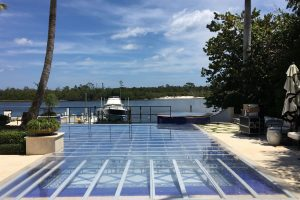 1,200 s.f. full clear acrylic deck pool cover with frosted edging at a private residence in Jupiter.